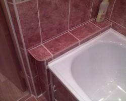 стык ванны с кафельной плиткой